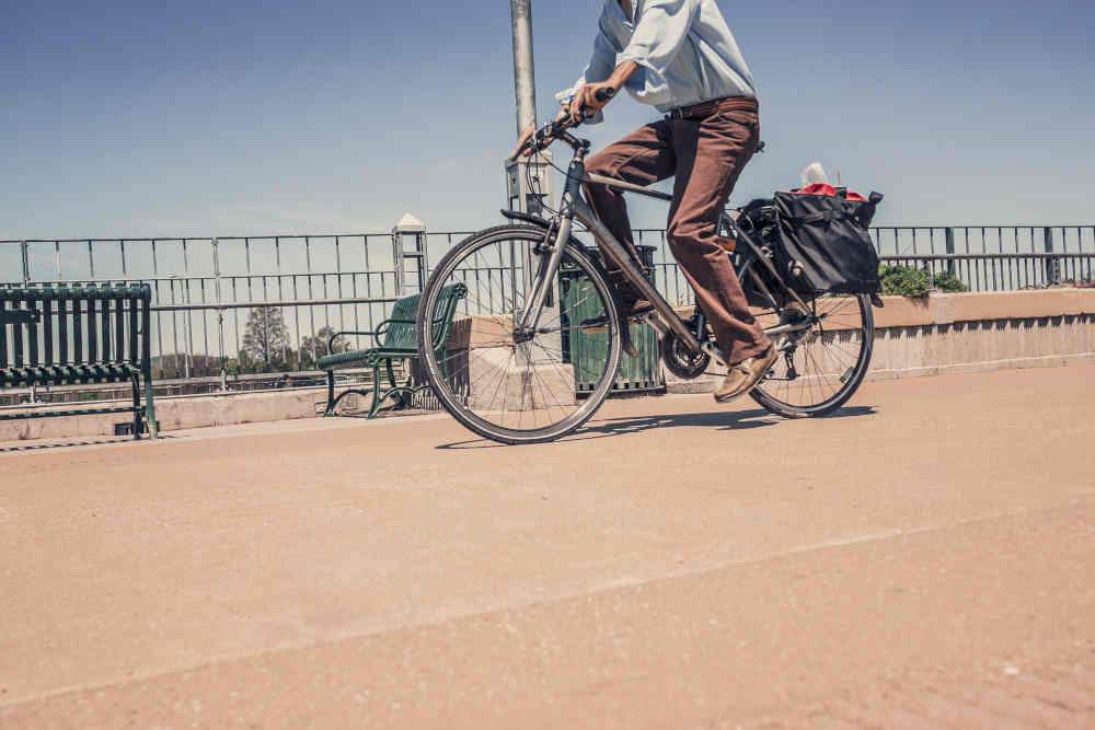 man cycling sunny